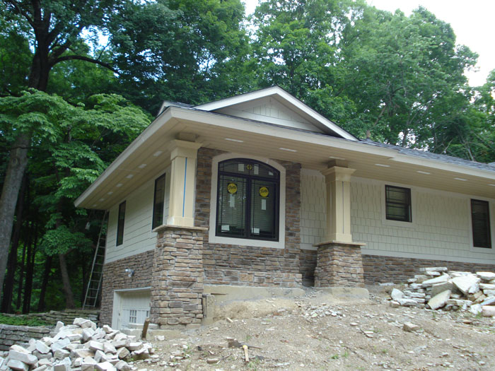 Ranch house additions siding ideas 1950 s ranch renovation for Garage addition designs