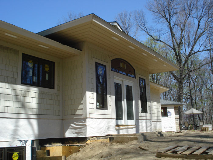 Rear house porch sunroom entrance family room addition for Bungalow addition cost